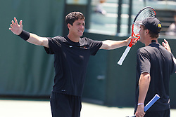 May 24, 2011; Stanford, CA, USA;  Southern California number 2 doubles player Emilio Gomez (left) celebrates with Steve Johnson (right) after winning their match against the Virginia Cavaliers during the finals of the men's team 2011 NCAA Tennis Championships at the Taube Tennis Center.