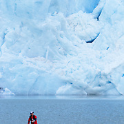 Chris Theobald stand up paddle boarding next to the Serrano Glacier in Bernado O'Higgins National Park, Chile.