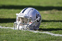 OAKLAND, CA - NOVEMBER 24: Detailed view of an Oakland Raiders helmet on the field before the game against the Tennessee Titans at O.co Coliseum on November 24, 2013 in Oakland, California. The Tennessee Titans defeated the Oakland Raiders 23-19. (Photo by Jason O. Watson/Getty Images) *** Local Caption ***
