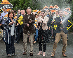 Scottish Lib Dem leader Willie Rennie celebrates quadrupling the party's MP's at the general election with champagne, with new MP's Jo SWinson and Christine Jardine and campaign manager Alex Cole Hamilton.<br /> <br /> &copy; Dave Johnston/ EEm