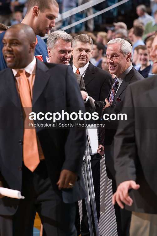 29 November 2005:  Head coach Bruce Weber and UNC head coach Roy Williams meet before an Illinois 68-64 victory over North Carolina in the Dean Smith Center in Chapel Hill, NC.