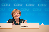 09 DEC 2014, KOELN/GERMANY:<br /> Angela Merkel, CDU, Bundeskanzlerin, CDU Bundesparteitag, Messe Koeln<br /> IMAGE: 20141209-01-155<br /> KEYWORDS: Party Congress, klatscht, applaudiert, Applaus, freundlich, lacht