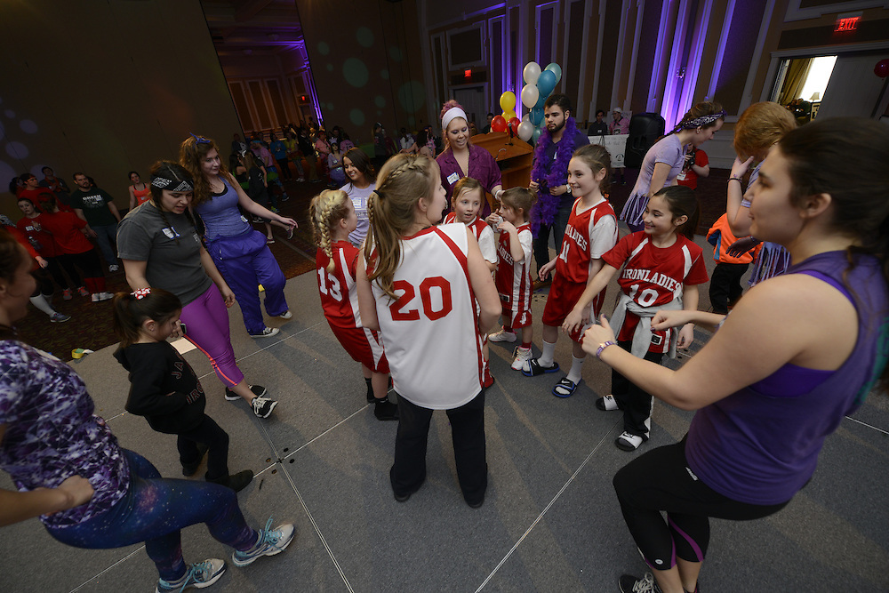 Members of the BobcaThon dance with the Iron Ladies from Jackso, Ohio. The community was invited to participate during the twelve hour event. Photo by Olivia Wallace
