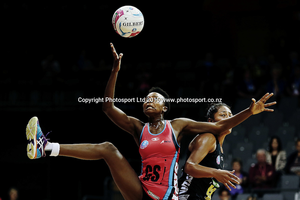 Mwai Kumwenda of the Tactix competes for the ball against Kristiana Manu'a of the Magic. 2015 ANZ Championship, Waikato Bay of Plenty Magic v Canterbury Tactix, Claudelands Arena, Hamilton, New Zealand. Photo: Anthony Au-Yeung / www.photosport.co.nz