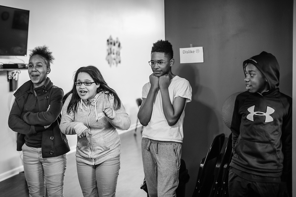 BALTIMORE, MD -- 3/2/16 -- From left: Jasmine Easley, Malaysia Rodriguez, Karee McDonald and Dayquan Wordard (cq), participate in a game at the center. <br /> <br /> Van Brooks runs the Safe Alternative Center, which he started to give middle school kids in West Baltimore a safe place to learn and play. <br /> <br /> Brooks was a Division 1 prospect when he played football in high school, but was paralyzed in a freak accident after making a tackle in his junior year. He regained the use of his arms, even walking again with much assistance, and graduated on time from high school. He later earned a degree in marketing from Towson University. Though still confined to a wheelchair, he is self-sufficient and runs the center.&hellip;by Andr&eacute; Chung #_AC22386