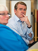 05 SEPTEMBER 2019 - DES MOINES, IOWA: US Senator MICHAEL BENNET (D-CO), right, and CELESTE KELLING, the school administrator, listen to teachers and staff at Jesse Franklin Taylor Education Center during an education roundtable Bennet hosted in Des Moines. Sen. Bennet is running for the Democratic nomination for the US Presidency in the 2020 election. Iowa traditionally hosts the the first election event of the presidential election cycle. The Iowa Caucuses will be on Feb. 3, 2020.             PHOTO BY JACK KURTZ