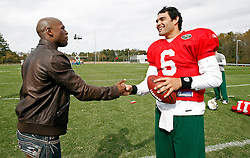 "October 8, 2009; Florham Park, NJ; USA; Floyd ""Money"" Mayweather shakes hands with New York Jets QB Mark Sanchez after the New York Jets practice in Florham Park, NJ."