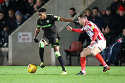Forest Green Rovers George Williams(11) holds off Cheltenham Town's Kevin Dawson(8) during the EFL Sky Bet League 2 match between Cheltenham Town and Forest Green Rovers at Jonny Rocks Stadium, Cheltenham, England on 29 December 2018.