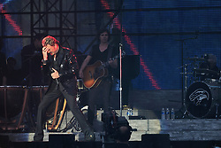 Johnny Hallyday performs during a free concert at the 'Champs de Mars' in front of the Eiffel Tower in Paris, France on July 14, 2009, for the celebration of the 120 years old of the Eiffel Tower and the Bastille Day. Photo Nicolas Genin/ABACAPRESS.COM