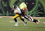 Cincinnati Bengals cornerback Dre Kirkpatrick (27) holds on for a ride as he tackles Pittsburgh Steelers tight end Heath Miller (83) after a pass reception during the NFL AFC Wild Card playoff football game against the Pittsburgh Steelers on Saturday, Jan. 9, 2016 in Cincinnati. The Steelers won the game 18-16. (©Paul Anthony Spinelli)
