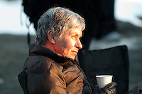 Betty Vogler listens to son Stephen Vogler tell stories at an outdoor gathering during the 2010 Olympic Winter Games in Whistler, BC