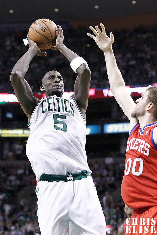 14 May 2012: Boston Celtics power forward Kevin Garnett (5) takes a jumpshot over Philadelphia Sixers center Spencer Hawes (00) during the Philadelphia Sixers 82-81 victory over the Boston Celtics, in Game 2 of the Eastern Conference semifinals playoff series, at the TD Banknorth Garden, Boston, Massachusetts, USA.