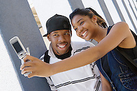 High School Couple Taking a Self Portrait