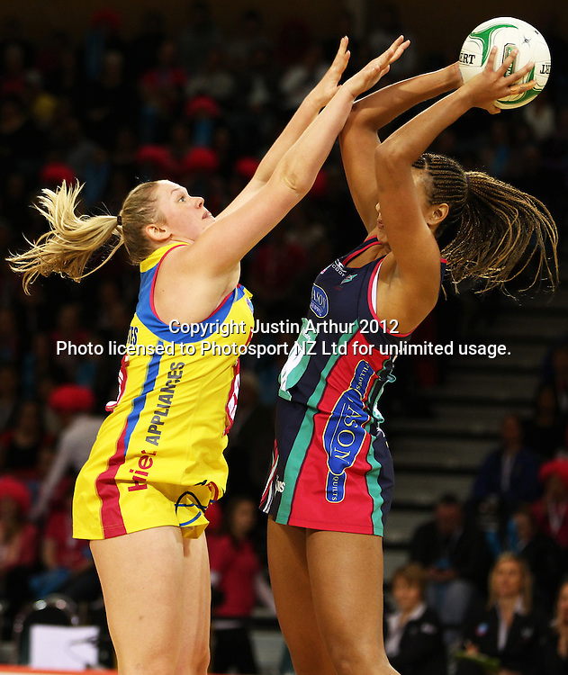 Pulse's Caitlin Thwaites looks to make a block on Vixens' Geva Mentor during the ANZ Netball Championship, Haier Pulse v Vixens at Te Rauparaha Arena, Porirua, New Zealand on Monday 25th of June 2012. Photo: Justin Arthur / photosport.co.nz