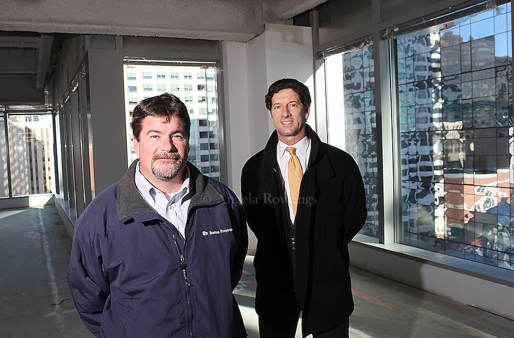(120210  Boston, MA) Boston Properties' Mark Denman, V.P. of construction, left, and Michael Cantalupa, senior vice president of development, inside the Atlantic Wharf project at corner of Atlantic Avenue and Congress Street,  Thursday,  December 02, 2010.  Staff photo by Angela Rowlings.