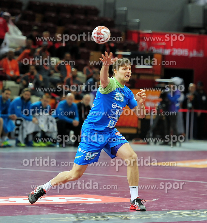 Marko Bezjak #25 of Slovenia during handball match between National Teams of Slovenia and Qatar at Day 5 of 24th Men's Handball World Championship Qatar 2015 on January 19, 2015 in Al Bin Hamad Al Attiya Arena, Doha, Qatar. Photo by Slavko Kolar / Sportida