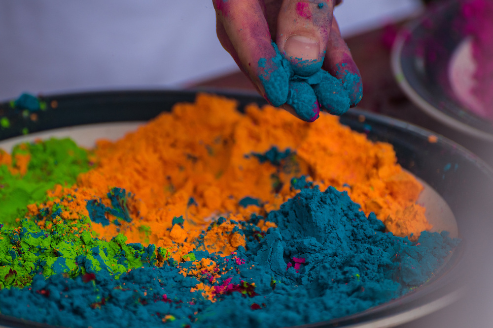 Hand picking up some powder for the Holi festival, Georgetown, Guyana.