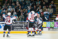 KELOWNA, CANADA - MARCH 27: Tyson Baillie #24, Leon Draisaitl #29 and Madison Bowey #4 of Kelowna Rockets celebrate a goal against the Tri-City Americans on March 27, 2015 at Prospera Place in Kelowna, British Columbia, Canada.  (Photo by Marissa Baecker/Shoot the Breeze)  *** Local Caption *** Madison Bowey; Tyson Baillie; Leon Draisaitl;