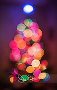 Christmas tree lights blurred out in abstract bokeh.