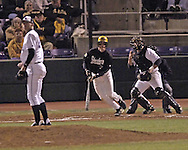 Wiichita State's Conor Gillaspie (left center) drives the ball to center field, as Kansas State pitcher Brad Hutt (far left) looks to the outfield in the top of the fourth inning.  K-State defeated the 19th ranked Shockers 6-3 at Tointon Stadium in Manhattan, Kansas, March 14, 2006.