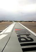 Alitalia passenger jet wing and logo