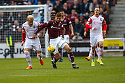Ross County Defender Andrew Davies and Hearts FC Forward Juanma Dalgado battle during the Ladbrokes Scottish Premiership match between Heart of Midlothian and Ross County at Tynecastle Stadium, Gorgie, Scotland on 24 October 2015. Photo by Craig McAllister.