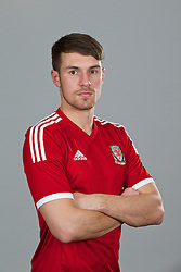 CARDIFF, WALES - Thursday, November 14, 2013: Wales' Aaron Ramsey wearing the new Wales 2013/2014 Adidas home jersey. (Pic by David Rawcliffe/Propaganda)