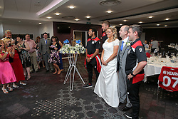 Korey Smith, Richard O'Donnell and Manager Lee Johnson of Bristol City pose with the newly married Mr and Mrs Kearney after they held their reception at Ashton Gate during the game - Rogan Thomson/JMP - 30/07/2016 - FOOTBALL - Ashton Gate Stadium - Bristol, England - Bristol City v Portsmouth - Pre-Season Friendly.