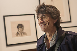 © licensed to London News Pictures. London, UK 13/08/2012. Ronnie Wood posing at the 'A Major Retrospective Of 50 Years Of Rock And Roll' exhibition in central London.  Photo credit: Tolga Akmen/LNP