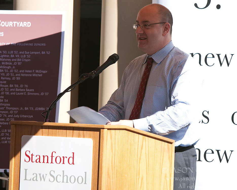 October 23, 2009; Stanford, CA USA;  Stanford Law School Dean Larry Kramer introduces United States Supreme Court Chief Justice John Roberts who visited Stanford Law School to take questions from first year law students and speak at the dedication of the Chief Justice William Rehnquist Courtyard.