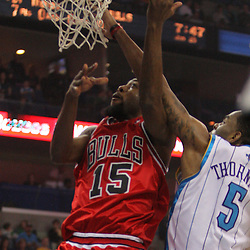 Jan 29, 2010; New Orleans, LA, USA; Chicago Bulls guard John Salmons (15) shoots over New Orleans Hornets guard Marcus Thornton (5) during the first half at the New Orleans Arena. Mandatory Credit: Derick E. Hingle-US PRESSWIRE