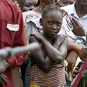 June 5, 2003 - A young Congolese girl stands in a crowd guarded by UPC soldiers at a rally for UPC president Thomas Lubanga in the village of  Iga Barriere some 25 kilometers away from Bunia. Photo by Evelyn Hockstein