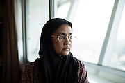 Angkhana Neelaphaijit stands in by the window in her office at the Human Rights Commission of Thailand.<br /> She is a Thai human rights activist and Commissioner of the Thai Human Rights Commission and the wife of disappeared human rights lawyer Somchai Neelaphaijit. In March 2004 her husband was abducted in central Bangkok and never seen again whilst he was defending a group men from the South of Thailand who were arrested on terrorism charges and claimed they were tortured in police custody.The people involved were never charged with anything more than coercion and gang-robbery as the body of Somchai Neelaphaijit was never found. <br /> She was a nurse and a housewife when her husband was abducted and since that day, during her 11 years long fight for justice on behalf of her husband, she has risen to become the Commissioner of the Thai Human Rights Commission.