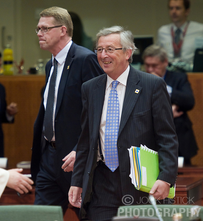 Jean-Claude Juncker, Luxembourg's prime minister, right, and Matti Vanhanen, Finland's prime minister, left, arrive for the European Summit meeting at EU Council headquarters in Brussels, Belgium, on Thursday, June 17, 2010. (Photo © Jock Fistick)