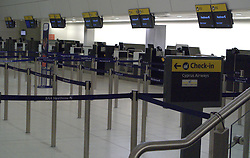 UK ENGLAND LONDON 15APR10 - Empty check-in counters at Heathrow's Terminal 1 awaiting further news of air traffic. Today the UK's airspace was totally closed due to high altitude ash clouds after a volcanic eruption in Iceland...jre/Photo by Jiri Rezac..© Jiri Rezac 2010