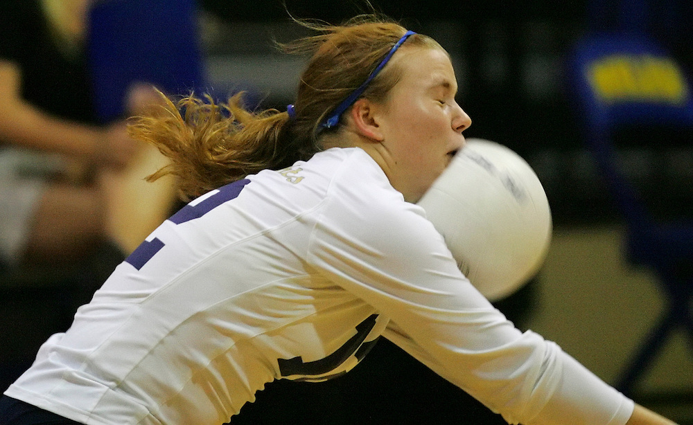 SPORTS - Alamo Heights player Kim Rohlfs is hit in the face as the ball ricochets off the floor Tuesday, October 2, 2007 at the Muledome. BAHRAM MARK SOBHANI/STAFF