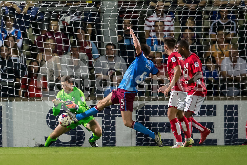 Murray Wallace of Scunthorpe United gets to the ball ahead of Frank Fielding of Bristol City but is only able to poke it wide of the post during the EFL Cup second round match between Scunthorpe United and Bristol City at Glanford Park, Scunthorpe, England on 23 August 2016. Photo by James Williamson.