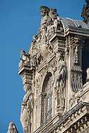 France. Paris.1 st district. Louvre, statue and Ornaments on Facade of Building