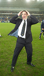 CARDIFF, WALES - Tuesday, January 24, 2012: Cardiff City's manager Malky Mackay celebrates his side's penalty shoot-out victory over Crystal Palace during the Football League Cup Semi-Final 2nd Leg at the Cardiff City Stadium. (Pic by David Rawcliffe/Propaganda)