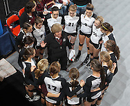The Mount Vernon Mustangs gather around head coach Shirley Ryan before the start of their 3A semifinal game in the state volleyball tournament at the U.S. Cellular Center at 370 1st Ave E on Friday afternoon, November 12, 2010. (Stephen Mally/Freelance)
