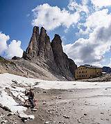 Hike a steep path to Rifugio Re Alberto and the Vajolet Towers/Torri del Vaiolet (2813 m) in the Rosengarten/Catinaccio Dolomites, Italy, Europe. From Pera di Fassa village (in Pozza di Fassa comune in Val di Fassa), in Trentino-Alto Adige/Südtirol region, Italy, take a bus or lift to visit Rifugio Gardeccia Hutte or other lodging and hike upwards in the Rosengarten mountain massif. 200 million years ago, Triassic coral reefs fossilized into Dolomite. Collision of tectonic plates lifted the Dolomites within the Southern Limestone Alps. UNESCO honored the Dolomites as a natural World Heritage Site in 2009. This panorama was stitched from 3 overlapping photos. For licensing options, please inquire.