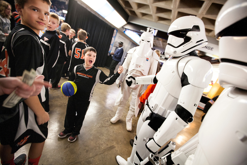 Austin Schommer, 8, center, of Farmington bumps fists with a Storm Trooper at Star Wars night at the Timberwolves game at Target Center in Minneapolis December 15, 2015.