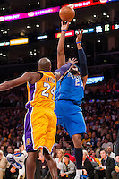30 October 2012: Forward (25) Vince Carter of the Dallas Mavericks shoots the ball as (24) Kobe Bryant of the Los Angeles Lakers put his hand in Carter's face during the first half of the Mavericks 99-91 victory over the Lakers at the STAPLES Center in Los Angeles, CA.
