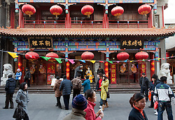 Busy street and ornate restaurant in Dashalan district on Beijing China