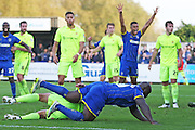 Bayo Akinfenwa of AFC Wimbledon header goes in, but the linesman flags for offside, during the Sky Bet League 2 match between AFC Wimbledon and Hartlepool United at the Cherry Red Records Stadium, Kingston, England on 31 October 2015. Photo by Stuart Butcher.