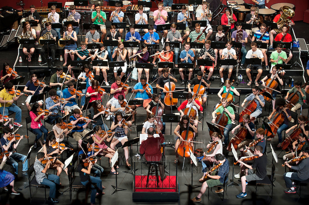 July 9, 2013 - Purchase, NY : Russian conductor Valery Gergiev, at bottom center, leads the National Youth Orchestra of the United States of America in  rehearsal at SUNY Purchase's Performing Arts Center in Westchester on Tuesday afternoon. The Orchestra, a new project of Carnegie Hall's Weill Music Institute, is comprised of musicians aged 16-19, hand-picked from across the country. The program -- and orchestra -- will kick off its inaugural season with a performance at SUNY Purchase on Thursday evening, and then head off to perform in Washington DC,  Moscow, St. Petersburg, and London. CREDIT: Karsten Moran for The New York Times