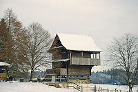An old, traditional, wooden building on the Lindenberg, Aargau, Switzerland in snowy winter.