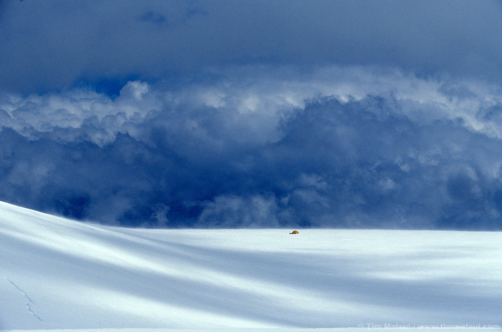 A tent on a windswept glacier during a storm in the British Columbia Coast Range.