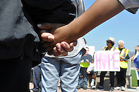 A mother and child hold hands at a march on Tuesday, August 6th from East Market and Towt Streets to Closter Park in response to the recent gun violence in Salinas. Students, parents, clergy and local officials carried signs and made their voices and prayers heard. The event was part of National Night Out, developed by the National Association of Town Watch, a non-profit organization dedicated to the development and promotion of various crime prevention programs devoted to safer communities.