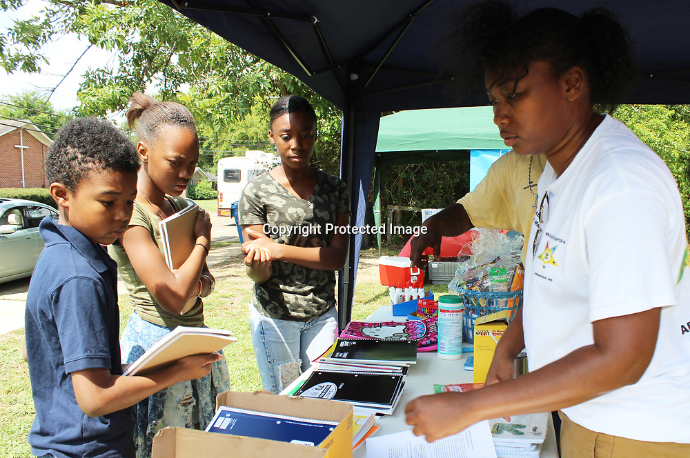 RAY VAN DUSEN/BUY AT PHOTOS.MONROECOUNTYJOURNAL.COM<br /> Order of the Eastern Star Associate Matron Kim Kelly, right, passes out school supplies to Aberdeen students as part of the group's school supply giveaway.